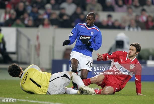 Rangers' DaMarcus Beasley is injured in a collision with VfB Stuttgart goalkeeper Raphael Schafer