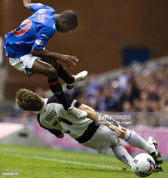 Rangers' DaMarcus Beasley is tackled by Gretna's Chris Innes during the Clydesdale Bank Premier League match at Ibrox Stadium Glasgow