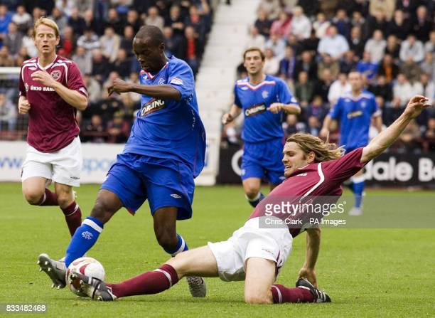 Rangers' DaMarcus Beasley is tackled by Hearts' Robbie Neilson during the Clydesdale Bank Scottish Premier League match at Tynecastle Stadium...
