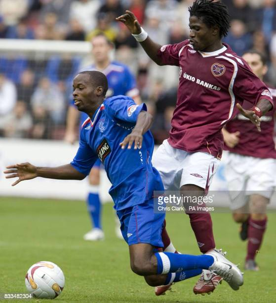 Rangers' DaMarcus Beasley of Rangers is tackled by Hearts' Laryea Kingston during the Clydesdale Bank Scottish Premier League match at Tynecastle...