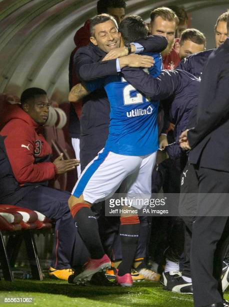Rangers Daniel Candeias celebrates scoring his side's third goal of the game with manager Pedro Caixinha during the Scottish Premiership match at New...