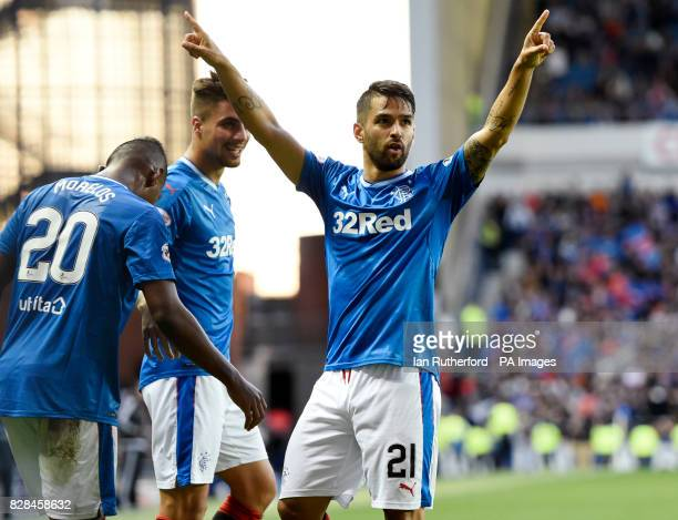 Rangers' Daniel Candeias celebrates with Alfredo Morelos and Fabio Cardoso after scoring the fifth goal during the Betfred Cup Second Round match at...