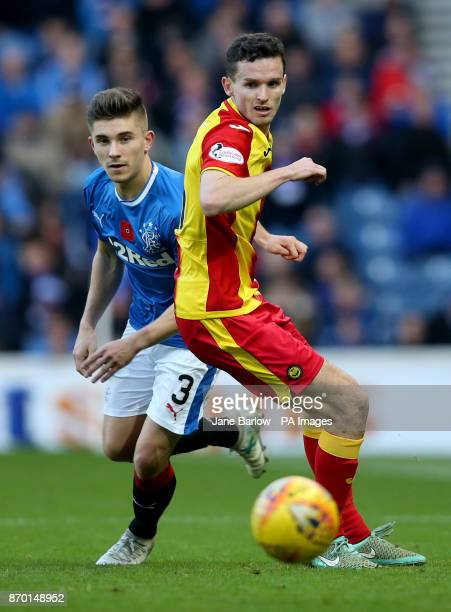 Rangers' Declan John and Partick Thistle's Paul McGinn battle for the ball during the Ladbrokes Scottish Premiership match at the Ibrox Stadium...