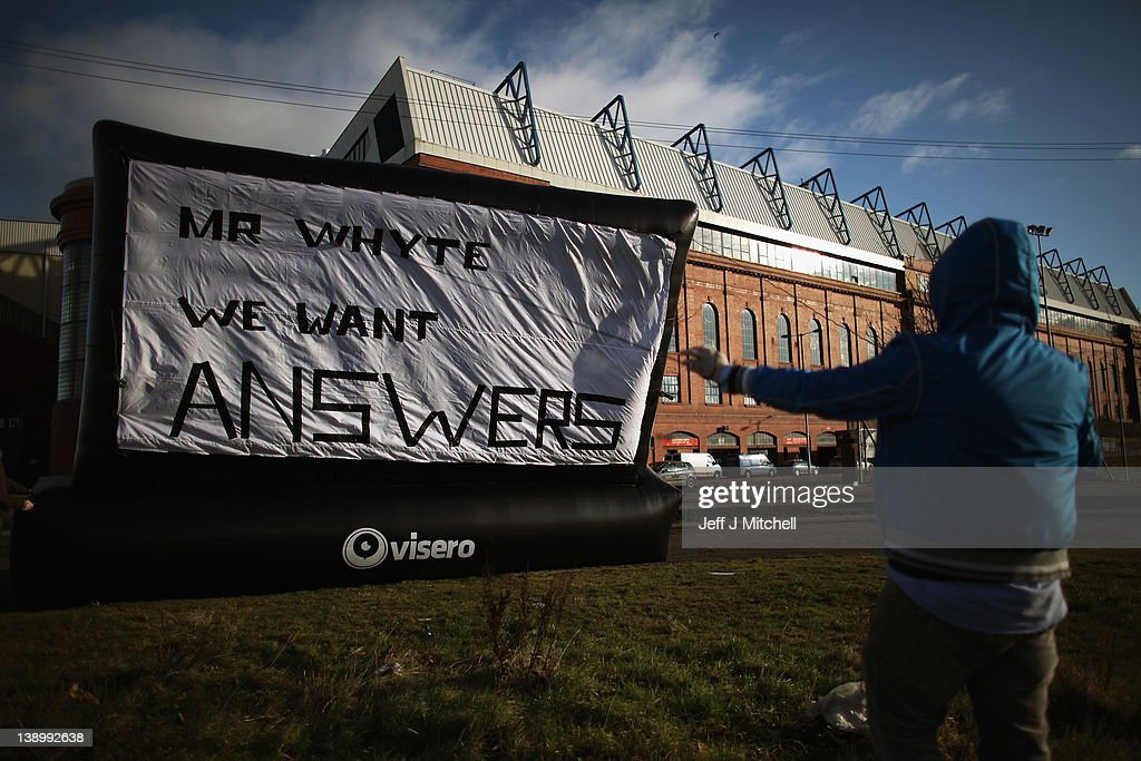 Rangers fan Michael Haggerty displays a banner outside directed to club owner Craig Whyte, outside the Ibrox Stadium on February 15, 2012 in Glasgow, Scotland. The Clydesdale Bank Premier League club entered administration yesterday over an unpaid tax bill of 9 million GBP.