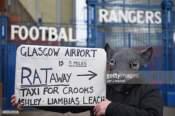 Rangers fan wearing a mask holds up a sign outside Ibrox stadium before the extraordinary general meeting on March 6 2015 in Glasgow Scotland...