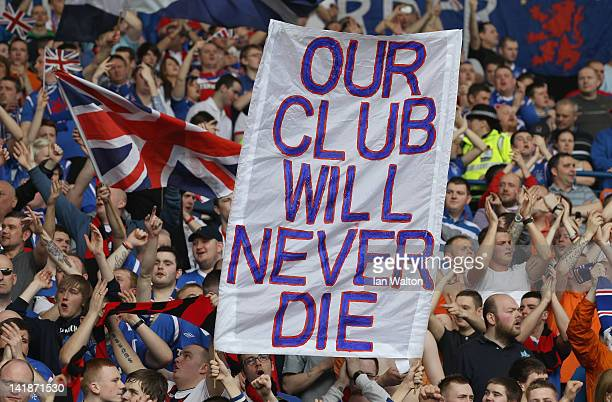 Rangers fans hold a banner aloft displaying the message 'our club will never die' during the Clydesdale Bank Scottish Premier League match between...