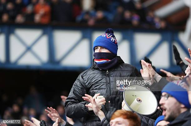 Rangers fans show their support during the Scottish Premier League match between Rangers and Inverness Caledonian Thistle at Ibrox Stadium on...