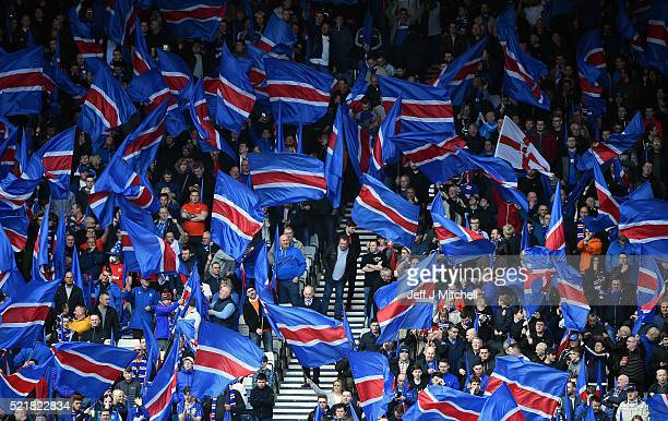 Rangers fans wave flags ahead of the William Hill Scottish Cup semi final between Rangers and Celtic at Hampden Park on April 17 2016 in Glasgow...
