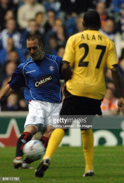 Rangers' Fernando Ricksen in action with FC Porto's Osorio Alan during the UEFA Champions League match at Ibrox Park Glasgow Tuesday September 13...