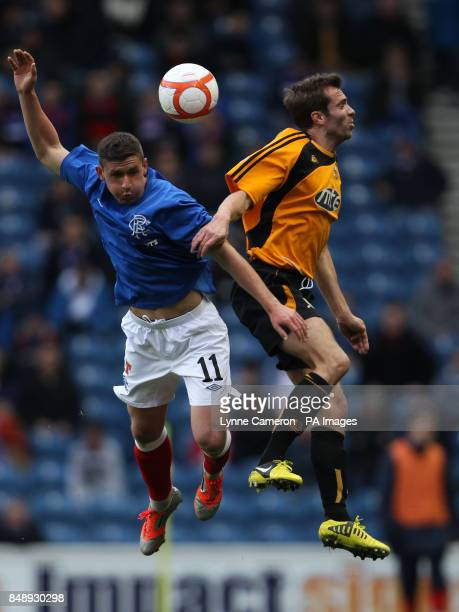 Ranger's Fraser Aird and Alloa's Ryan McCord during the William Hill Scottish Cup Third Round match at Ibrox Stadium Glasgow