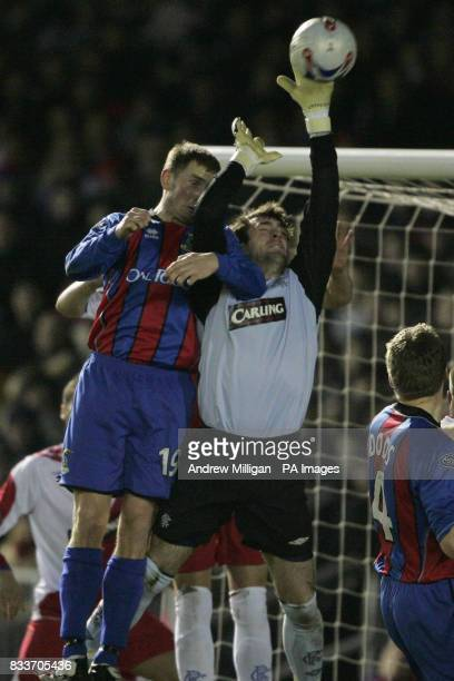 Rangers goal keeper Allan McGregor challenges Inverness Caledonian Thistle's Dennis Wyness during the Bank of Scotland Premier League match at...