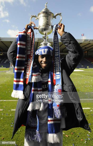 Rangers' goal scorer DaMarcus Beasley lifts the trophy following their victory in the Scottish Cup Final at Hampden Park Glasgow