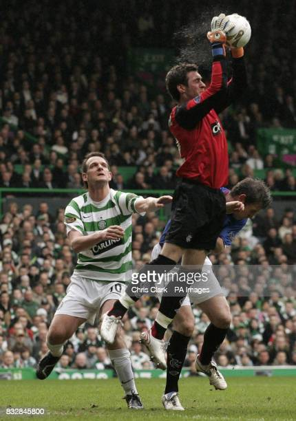Rangers' goalkeeper Allan McGregor catches the ball as Celtic's Jan Vennegoor of Hesselink watches during the Bank of Scotland Premier League at...