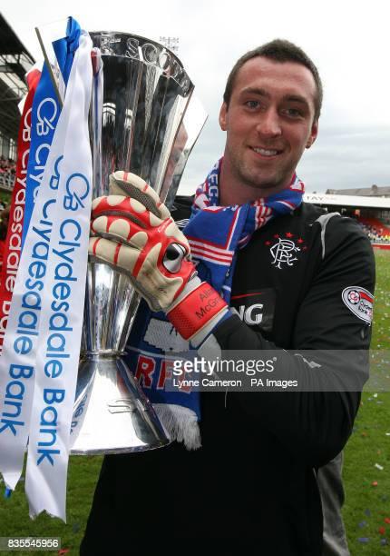 Rangers goalkeeper Allan McGregor celebrates with the SPL Trophy