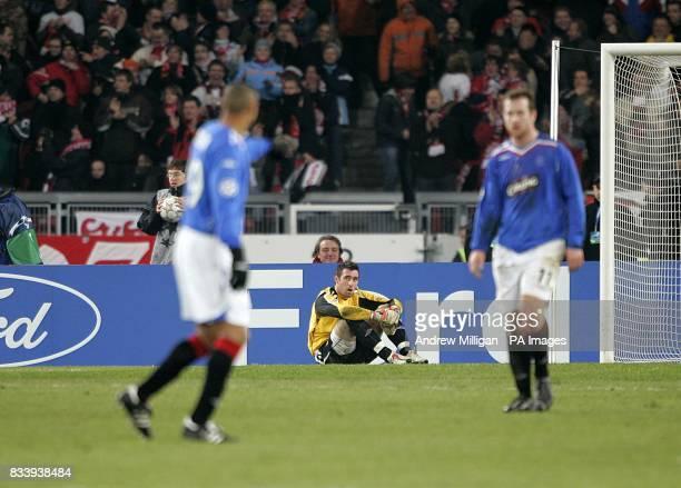 Rangers goalkeeper Allan McGregor dejected after Vfb Stuttgart's Ciprian Marica scores their sides third goal of the match