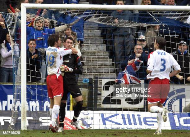 Rangers goalkeeper Allan McGregor is hugged by Karl Svensson after he saved a penalty during the Bank of Scotland Premier League match against...