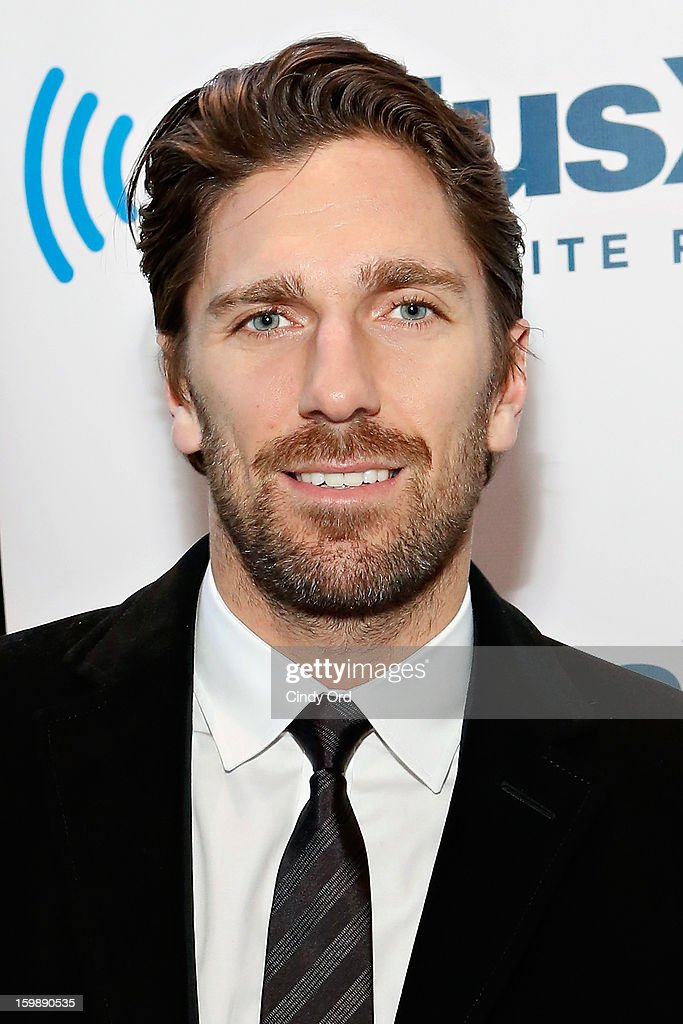 NY Rangers goaltender and reigning Vezina Trophy winner Henrik Lundqvist visits SiriusXM's 'Mad Dog Unleashed' hosted by Chris 'Mad Dog' Russo at the NHL Powered by Reebok Store on January 22, 2013 in New York City.