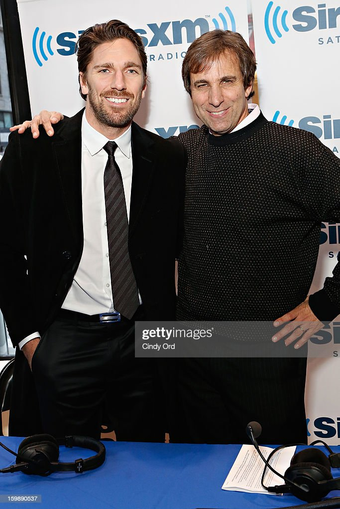 NY Rangers goaltender and reigning Vezina Trophy winner <a gi-track='captionPersonalityLinkClicked' href=/galleries/search?phrase=Henrik+Lundqvist&family=editorial&specificpeople=217958 ng-click='$event.stopPropagation()'>Henrik Lundqvist</a> poses with SiriusXM host Chris 'Mad Dog' Russo prior to an interview on SiriusXM's 'Mad Dog Unleashed' at the NHL Powered by Reebok Store on January 22, 2013 in New York City.