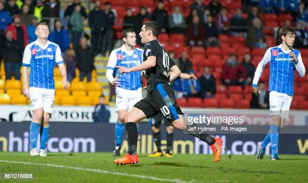 Rangers Graham Dorrans celebrates scoring his side's third goal of the game during the Ladbrokes Scottish Premiership match at McDiarmid Park Perth