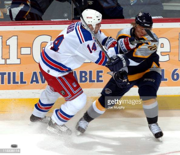 Rangers Jason Ward cross checks Martin Erat during the 3rd period of the game between the New York Rangers and the Nashville Predators at the Gaylord...