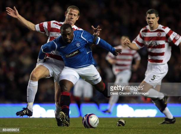 Rangers Jean Claude Darcheville holds off Hamilton Academicals' Chris Swailes during the CIS Insurance Cup match at Ibrox Stadium Glasgow