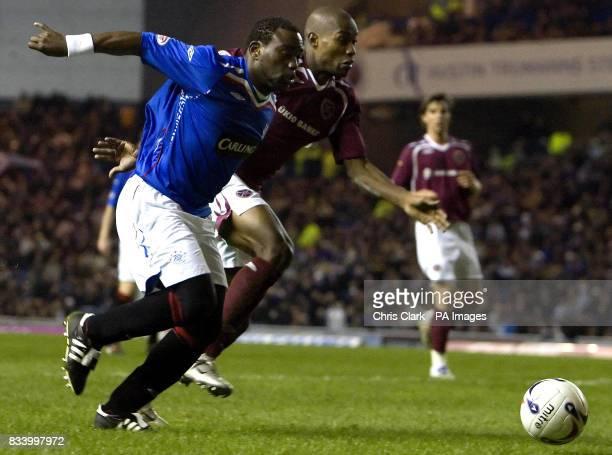Rangers' JeanClaude Darcheville battles with Hearts' Jose Goncalves during the Clydesdale Bank Scottish Premier League match at Ibrox Stadium Glasgow