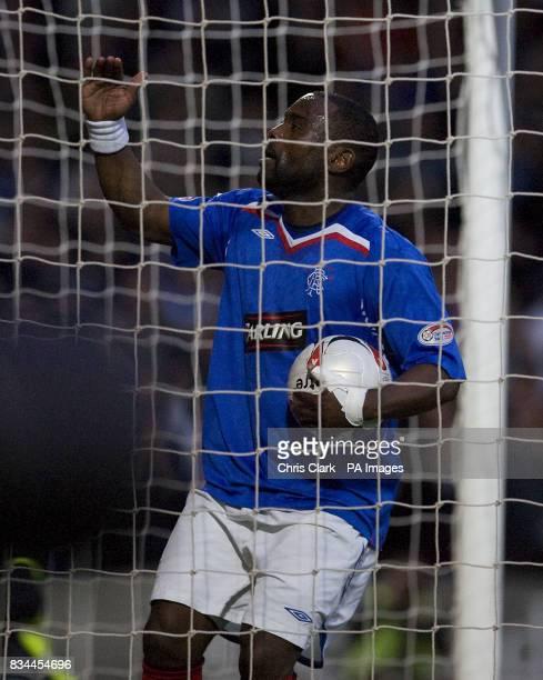 Rangers' JeanClaude Darcheville celebrates scoring his sides' third goal against St Mirren during the Clydesdale Bank Premier League match at St...