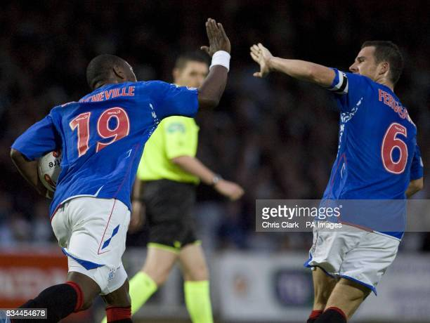 Rangers' JeanClaude Darcheville celebrates with Barry Ferguson after scoring his sides' third goal during the Clydesdale Bank Premier League match at...