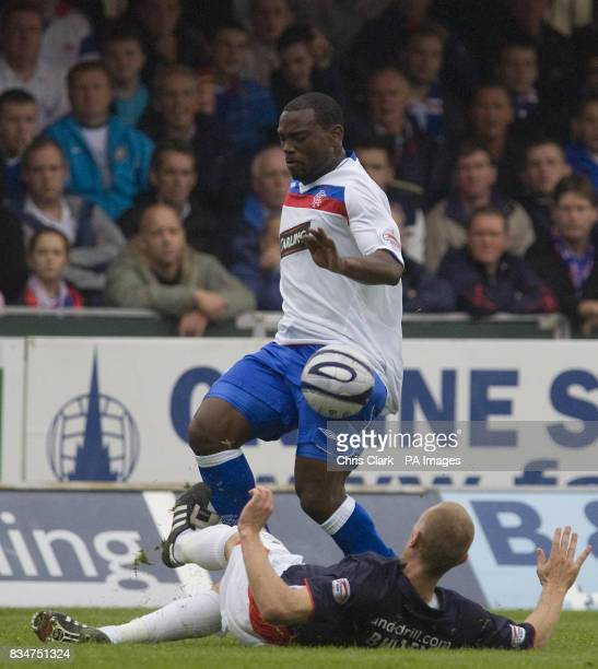 Rangers' JeanClaude Darcheville is tackled by Falkirk's Lee Bullen during the Clydesdale Bank Scottish Premier League match at The Falkirk Stadium...