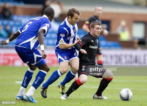 Rangers' John Fleck holds off Kilmarnock's Liam Kelly during the Clydesdale Bank Premier League at Rugby Park Kilmarnock