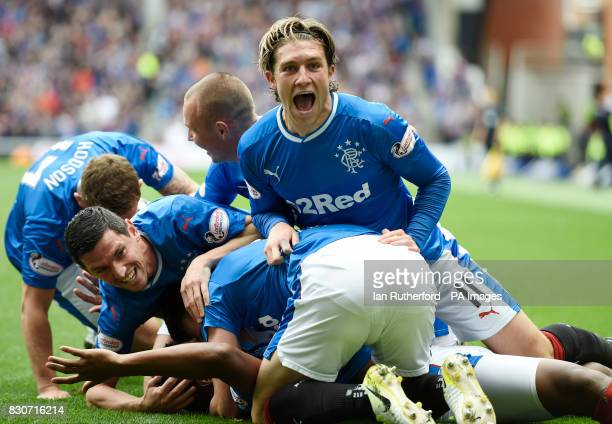 Rangers' Josh Windass celebrates after Alfredo Morelos scores his side's first goal with teammates during the Ladbrokes Scottish Premiership match at...