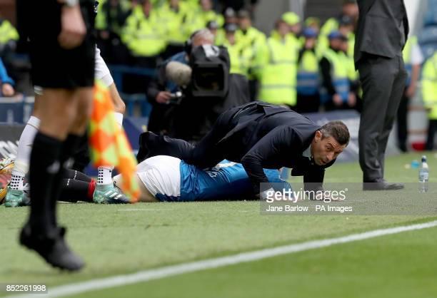 Rangers' Josh Windass crashes into manager Pedro Caixinha during the Ladbrokes Scottish Premiership match at the Ibrox Stadium Glasgow