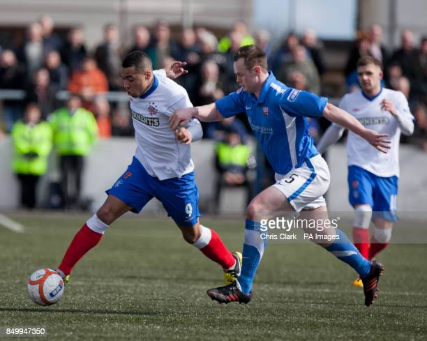Rangers' Kane Hemmings battles for the ball with Montrose's Cammy MacDonald during the Irn Bru Scottish Division Three match at Links Park Montrose