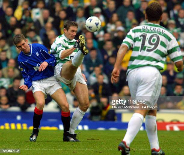 Rangers Kenny Miller tussles for the ball with Celtic's Tom Boyd during today's Sunday 26th November 2000 Scottish Premier League match at Ibrox...