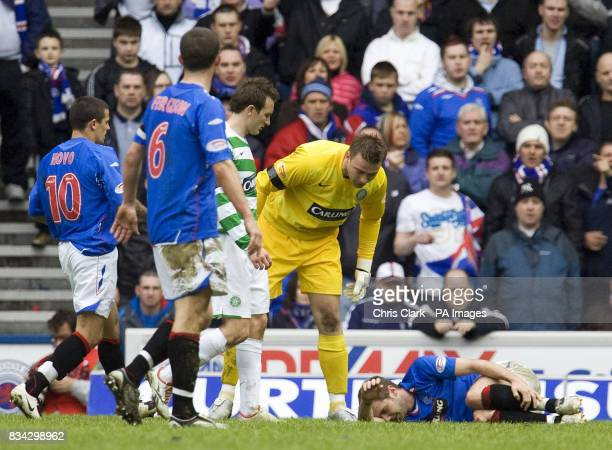 Rangers' Kevin Thomson lies injured as Celtic goalkeeper Artur Boruc leans over during the Clydesdale Bank Scottish Premier League match at Ibrox...