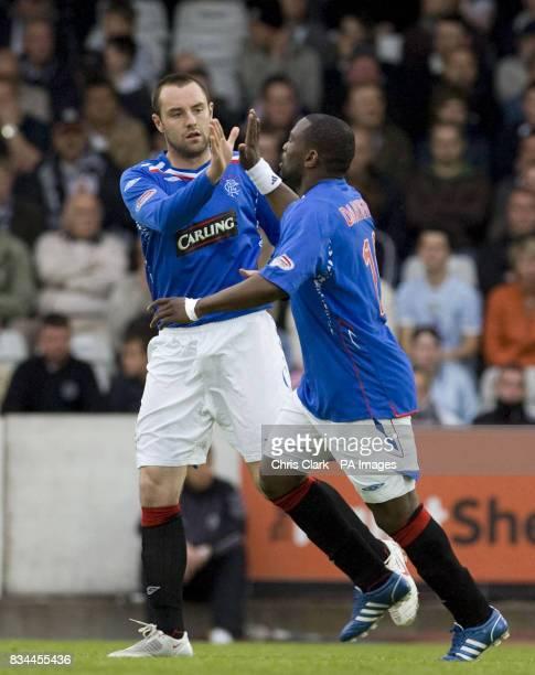 Rangers' Kris Boyd celebrates scoring with JeanClaude Darcheville during the Clydesdale Bank Premier League match at St Mirren Park Paisley