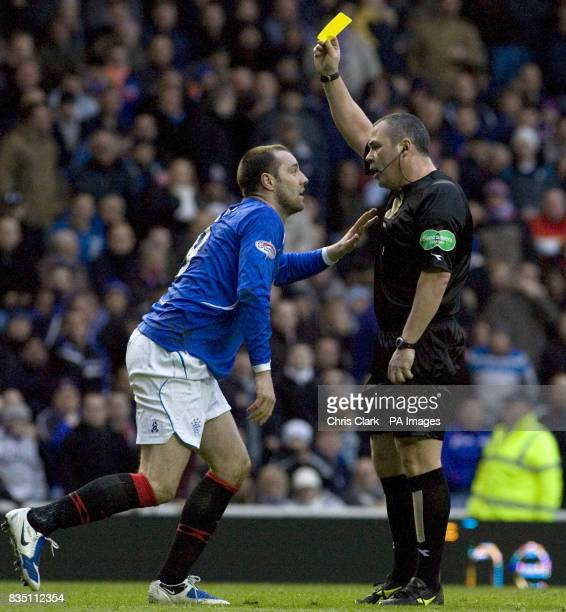Rangers' Kris Boyd is booked by referee Brian Winter for diving during the Clydesdale Bank Scottish Premier League match at Ibrox Glasgow