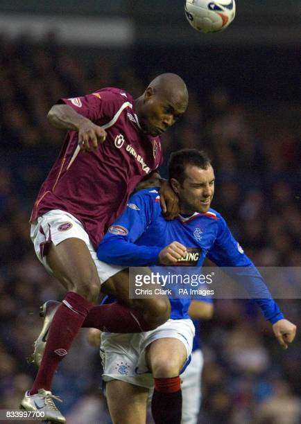 Rangers' Kris Boyd is tackled by Hearts' Jose Goncalves during the Clydesdale Bank Scottish Premier League match at Ibrox Stadium Glasgow