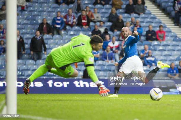 Rangers Kris Boyd scores his sides first goal during the Petrofac Training Cup Second Round match at Ibrox Stadium Glasgow
