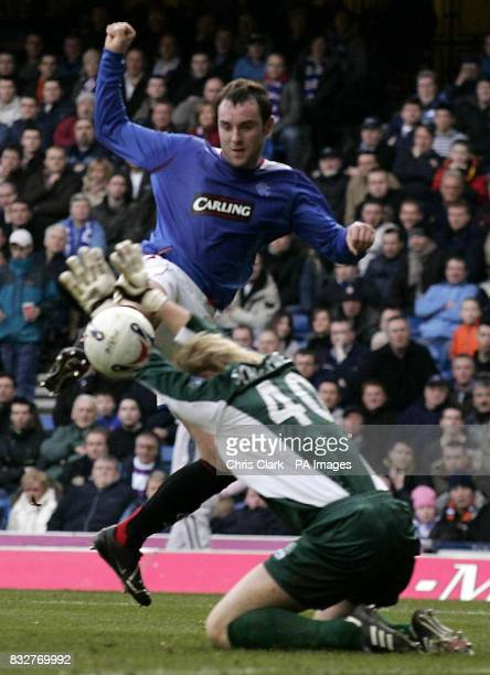Rangers' Kris Boyd scores past Falkirk goalkeeper Kasper Schmeichel during the Bank of Scotland Premier League match at Ibrox Glasgow
