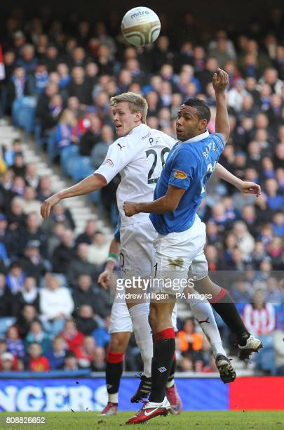 Rangers Kyle Bartley challenges Motherwells Jonathan Page during the Clydesdale Bank Scottish Premier League match at Ibrox Stadium Glasgow