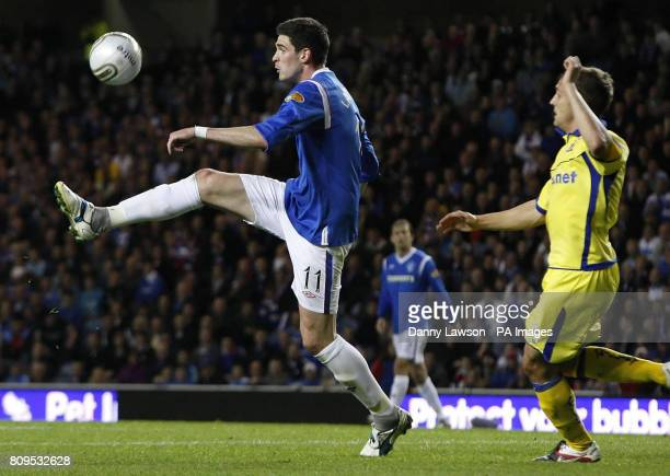 Rangers' Kyle Lafferty beats Kilmarnock's Liam Kelly to the ball during the Clydesdale Bank Scottish Premier League match at Ibrox Stadium Glasgow