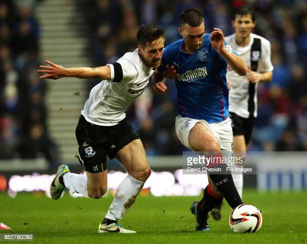 Rangers Lee Walace holds off Ayr's Adam Hunter during the Scottish League One match at Ibrox Stadium Glasgow
