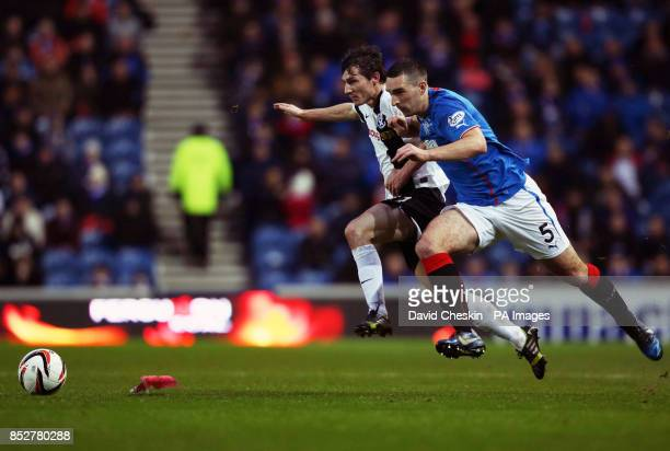 Rangers Lee Walace holds off Ayr's Michael Donald during the Scottish League One match at Ibrox Stadium Glasgow