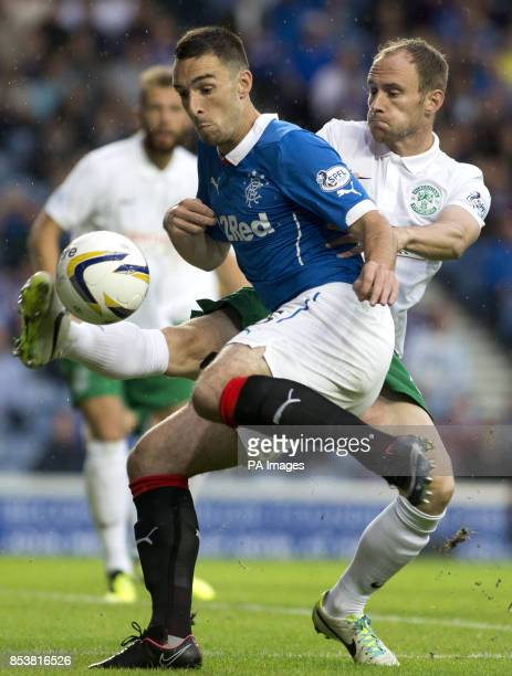 Rangers' Lee Wallace and Hibernian's David Gray during the Petrofac Training Cup match at Ibrox Glasgow