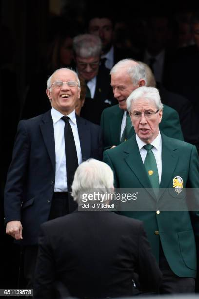 Rangers legend Willie Henderson leaves with former Celtic players Bobby Lennox and Jim Craig following the funeral service for Lisbon Lion footballer...