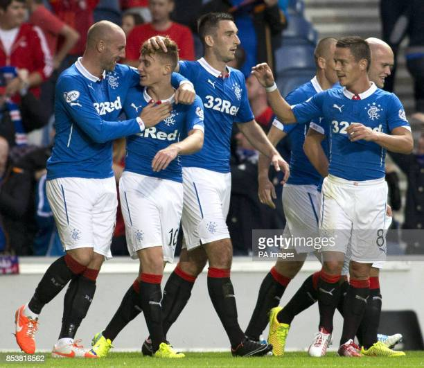 Rangers' Lewis Macleod celebrates his goal with his team mates during the Petrofac Training Cup match at Ibrox Glasgow
