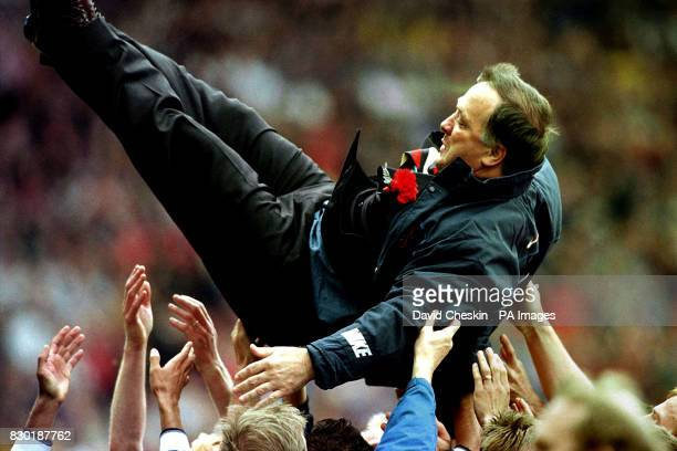 Rangers' manager Dick Advocaat is held above his team after they won the Tennents Scottish Cup final at Hampden Park in Glasgow defeating Celtic 10