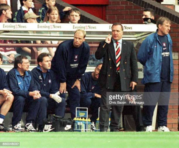 Rangers manager Dick Advocaat signals to his team during their match against Hearts at Tynecastle today Next to him is first team coach Tommy Moller...
