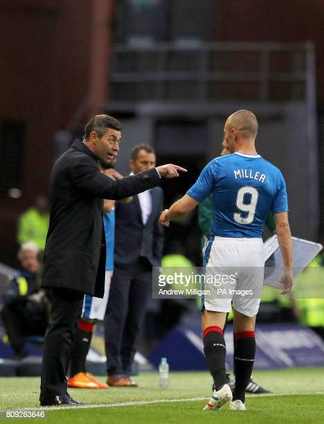 Rangers manager Pedro Caixinha speaks with Kenny Miller from the touchline
